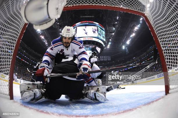 Brian Boyle of the New York Rangers runs into goaltender Jonathan Quick of the Los Angeles Kings in the first period during Game Two of the 2014 NHL...