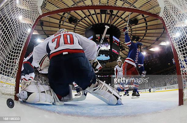 Brian Boyle of the New York Rangers scores at 1250 of the first period against Braden Holtby of the Washington Capitals in Game Three of the Eastern...
