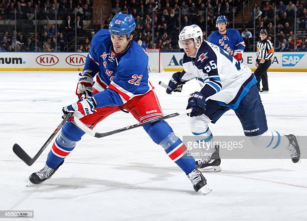 Brian Boyle of the New York Rangers skates with the puck against the Winnipeg Jets at Madison Square Garden on December 2 2013 in New York City The...