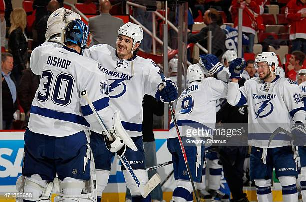 Brian Boyle of the Tampa Bay Lightning celebrates a 52 win over the Detroit Red Wings with Ben Bishop in Game Six of the Eastern Conference...