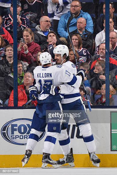 Brian Boyle of the Tampa Bay Lightning celebrates his gamewinning goal with teammate Alex Killorn of the Tampa Bay Lightning during the third period...
