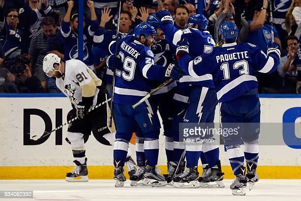 Brian Boyle of the Tampa Bay Lightning celebrates with his teammates after scoring a goal on Matt Murray of the Pittsburgh Penguins during the third...