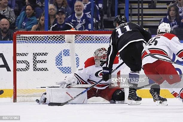 Brian Boyle of the Tampa Bay Lightning shoots the puck for a goal against goalie Cam Ward of the Carolina Hurricanes during first period at Amalie...