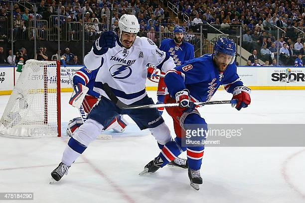 Brian Boyle of the Tampa Bay Lightning skates for the puck against Kevin Klein of the New York Rangers during the first period in Game Seven of the...
