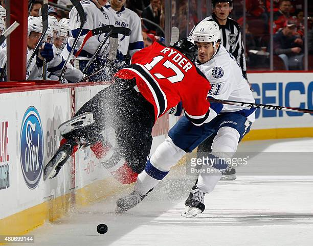 Brian Boyle of the Tampa Bay Lightning takes two minutes for tripping and Michael Ryder of the New Jersey Devils takes two for embellishment during...