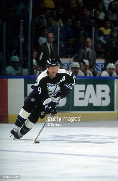 Brian Bradley of the Tampa Bay Lightning skates with the puck during an NHL game against the New York Islanders on January 28, 1995 at the Nassau...