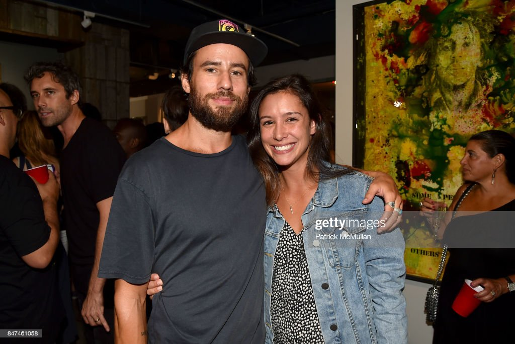 Brian Britt and Caitlin Cotroneo attend IV New York Gallery Grand Opening Exhibition on September 14, 2017 in New York City.