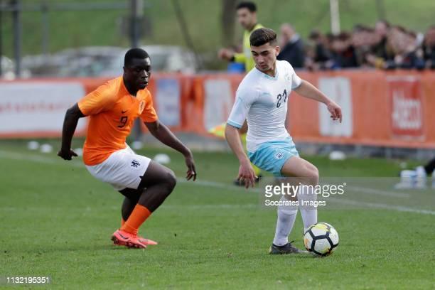 Brian Brobbey of Holland U17 Raz Bruchian of Israel U17 during the match between Holland U17 v Israel U17 at the Sportpark Zegersloot on March 23...