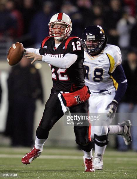 Brian Brohm of the Louisville Cardinals looks to pass against Pat Liebig of the West Virginia Mountaineers November 2 20006 at Papa John's Cardinal...