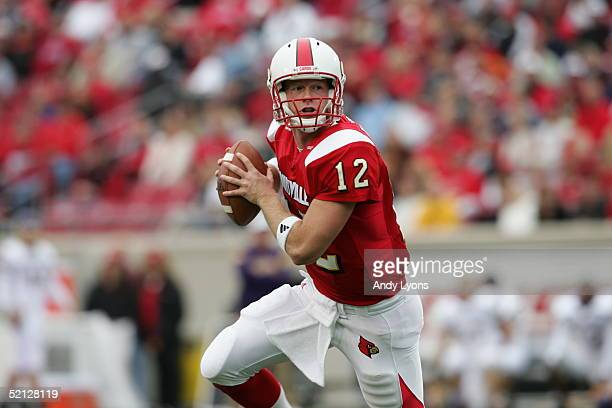Brian Brohm of the Louisville Cardinals looks to pass during the game against the East Carolina Pirates at Papa John's Stadium on October 2 2004 in...