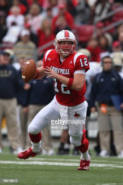 Brian Brohm of the Louisville Cardinals looks to pass during the game against the Pittsburgh Panthers at Papa Johns Cardinal Stadium on October 27...