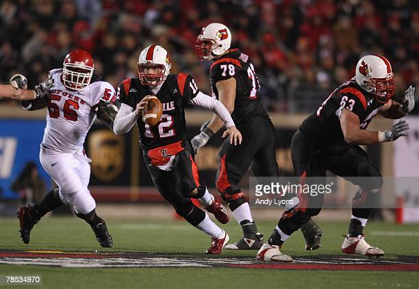 Brian Brohm of the Louisville Cardinals scrambles out of the pocket during the Big East Conference game against the Rutgers Scarlet Knights on...