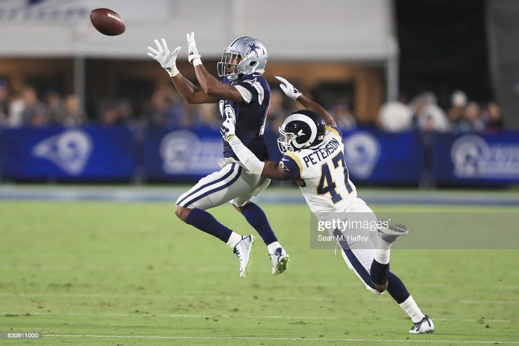 Brian Brown #18 of the Dallas Cowboys completes the pass during the third quarter of the preseason game between the Los Angeles Rams and the Dallas Cowboys at the Los Angeles Memorial Coliseum on August 12, 2017 in Los Angeles, California.