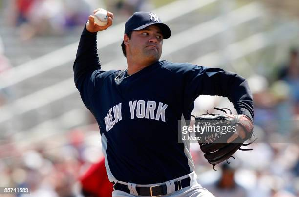 Brian Bruney of the New York Yankees pitches against the Cincinnati Reds during a Grapefruit League Spring Training Game at Ed Smith Stadium on March...