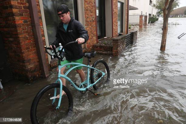 Brian Buckley walks through a flooded street as Hurricane Sally passes through the area on September 16, 2020 in Pensacola, Florida. The storm is...