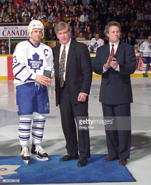 Brian Burke of the NHL and former Leaf Darryl Sittler present Doug Gilmmour of the Toronto Maple Leafs with an award for achieving 1000 points prior...
