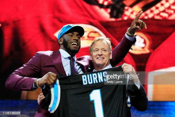 Brian Burns of Florida State poses with NFL Commissioner Roger Goodell after being chosen overall by the Carolina Panthers during the first round of...
