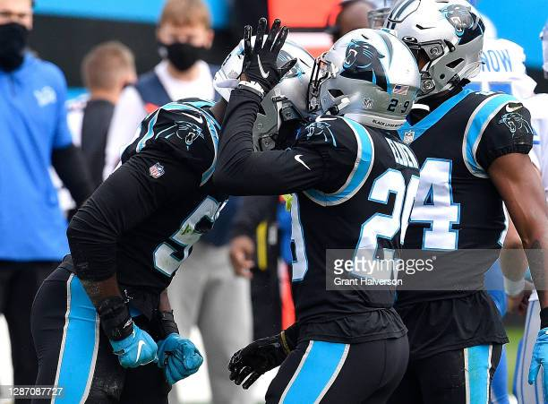 Brian Burns of the Carolina Panthers reacts with Corn Elder after a pass breakup against the Detroit Lions during the first half at Bank of America...