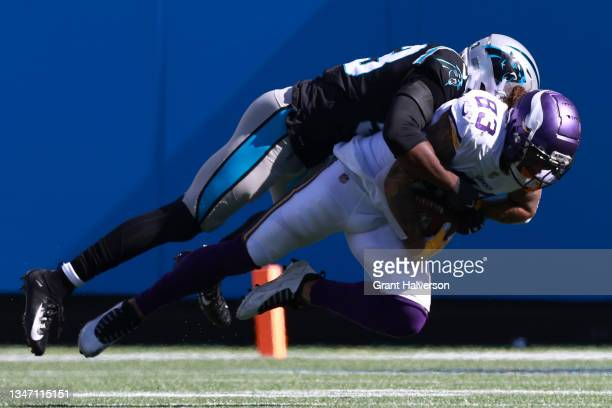 Brian Burns of the Carolina Panthers tackles Tyler Conklin of the Minnesota Vikings during the third quarter at Bank of America Stadium on October...