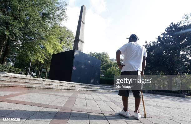 Brian Burrell pauses to look at a now covered confederate monument in Linn Park on August 18 2017 in Birmingham Alabama Alabamas attorney general...