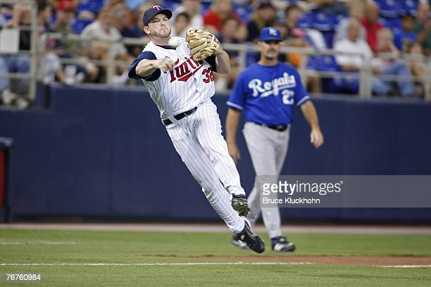 Brian Buscher of the Minnesota Twins fields the ball in a game against the Kansas City Royals at the Humphrey Metrodome in Minneapolis Minnesota on...