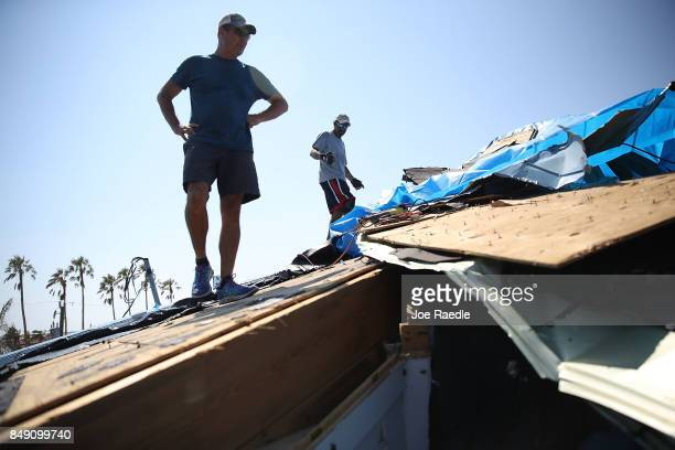 Brian Callihan and Davis Calderon survey a room that was badly damaged by Hurricane Irma on September 18 2017 in Sugarloaf Key Florida The process of...