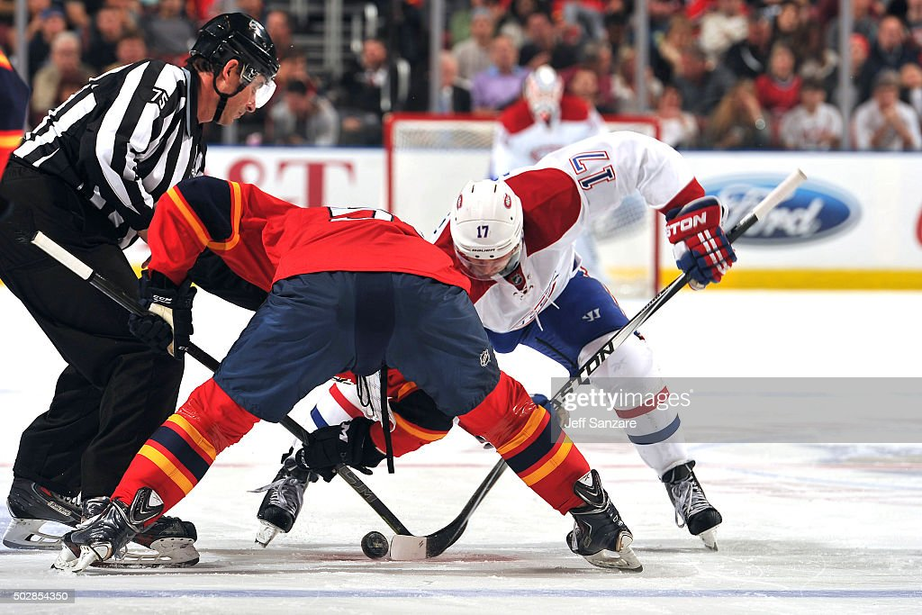 Brian Campbell #51 faces off against Torrey Mitchell #17 of the Montreal Canadiens during second period action at the BB&T Center on December 29, 2015 in Sunrise, Florida.