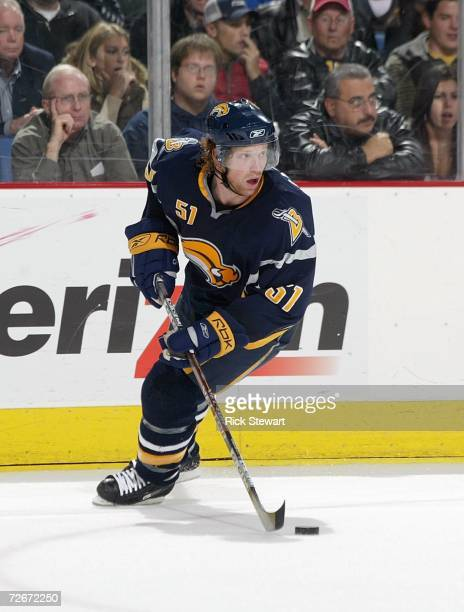 Brian Campbell of the Buffalo Sabres skates with the puck during the game against the Ottawa Senators on November 15, 2006 at HSBC Arena in Buffalo,...