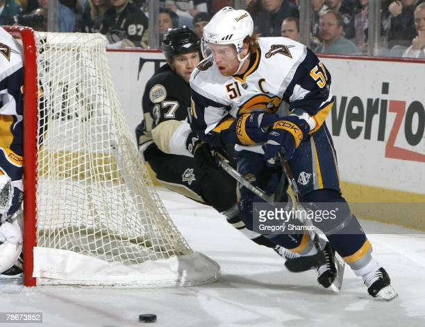Brian Campbell of the Buffalo Sabres tries to get around Jarkko Ruutu of the Pittsburgh Penguins at Mellon Arena December 29 2007 in Pittsburgh...