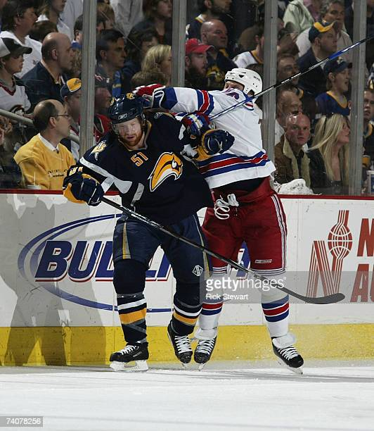 Brian Campbell of the Buffalo Sabresmisses the swing made by Sean Avery of the NY Rangers during Game 5 of the 2007 Eastern Conference Semifinals at...