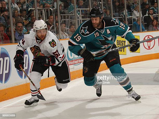 Brian Campbell of the Chicago Blackhawks battles for the puck with Joe Thornton of the San Jose Sharks in Game One of the Western Conference Finals...