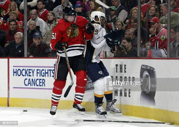 Brian Campbell of the Chicago Blackhawks pushes into Joel Ward of the Nashville Predators on October 24 2009 at the United Center in Chicago Illinois