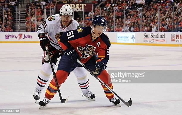 Brian Campbell of the Florida Panthers and Marian Hossa of the Chicago Blackhawks chase after the puck during a game at BBT Center on January 22 2016...