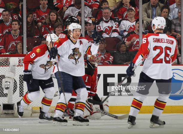 Brian Campbell of the Florida Panthers celebrates his game winning goal against the New Jersey Devils in Game Three of the Eastern Conference...