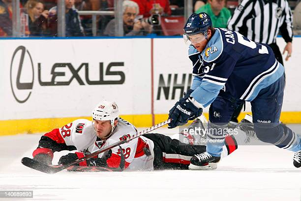Brian Campbell of the Florida Panthers tangles with Zenon Konopka of the Ottawa Senators at the BankAtlantic Center on March 4 2012 in Sunrise Florida