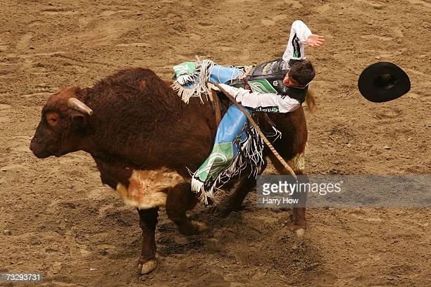 Brian Canter attempts to ride Aces Heart Breaker on his way to a second place finish during the final of the PBR Amp'd Mobile Invitational in the...