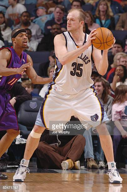 Brian Cardinal of the Memphis Grizzlies looks to move the ball against Rafer Alston of the Toronto Raptors during the game at FedexForum on March 4...