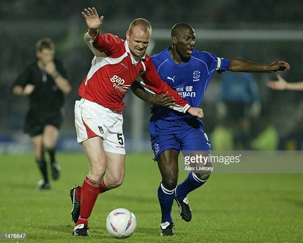 Brian Carey of Wrexham battles with Kevin Campbell of Everton during the Worthington Cup second round match between Wrexham and Everton at the...