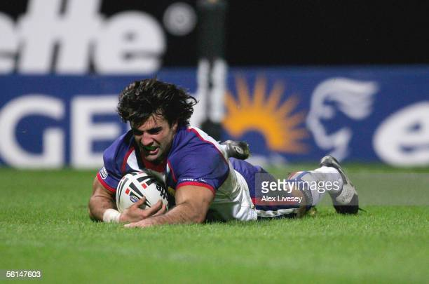 Brian Carney of Great Britain dives over the line for his second try during the Tri Nations match between Great Britain and New Zealand at the...