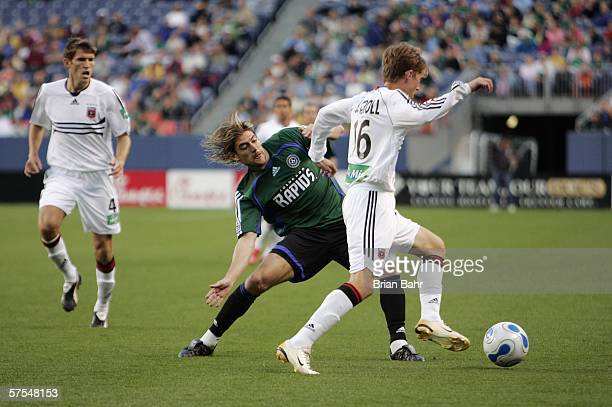 Brian Carroll of the DC United goes around Nicolas Hernandez of the Colorado Rapids in the first half on May 6 2006 at Invesco Field at Mile High in...