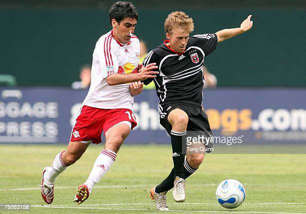 Brian Carroll shields the ball from Claudio Reyna DC United trounced the New York Redbulls 41 behind a Ben Olsen hat trick at RFK stadium in...