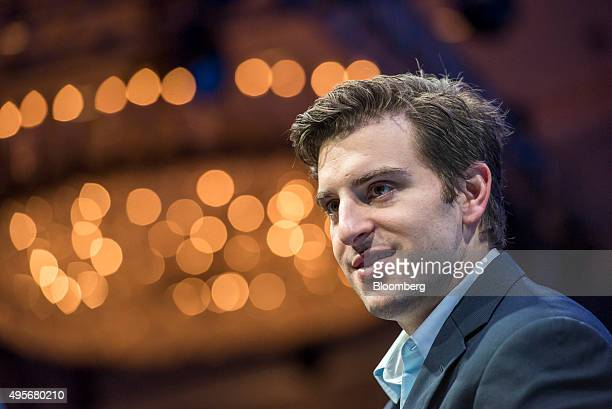 Brian Chesky cofounder and chief executive officer of Airbnb Inc listens during the 2015 Fortune Global Forum in San Francisco California US on...