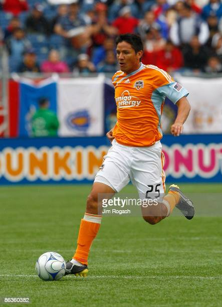 Brian Ching of the Houston Dynamo battles the New England Revolution at Gillette Stadium on May 3 2009 in Foxborough Massachusetts