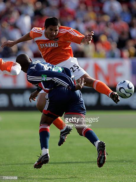 Brian Ching of the Houston Dynamo clashes with Avery John of the New England Revolution as they vie for the ball during the 2006 MLS Cup at Pizza Hut...