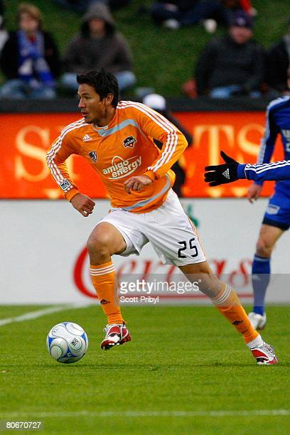 Brian Ching of the Houston Dynamo dribbles the ball against the Kansas City Wizards during the game at Community America Ballpark on April 12 2008 in...