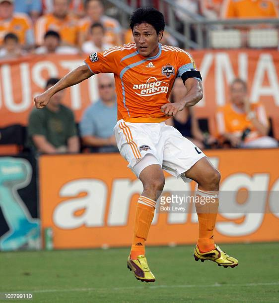 Brian Ching of the Houston Dynamo follows through after putting a shot on goal in the first half against the Columbus Crew at Robertson Stadium on...