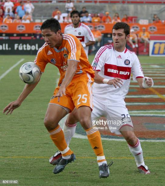 Brian Ching of the Houston Dynamo keeps the ball away from Gonzalo Segares of the Chicago Fire on August 31 2008 at Robertson Stadium in Houston Texas