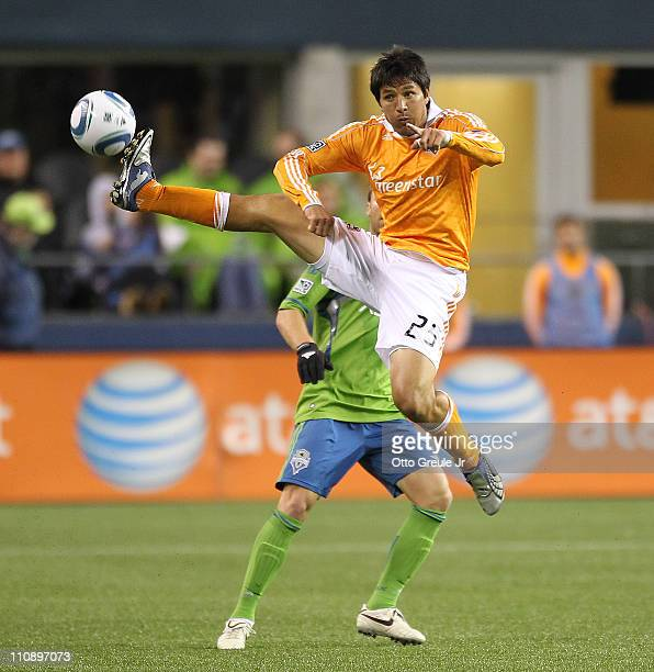 Brian Ching of the Houston Dynamo passes against the Seattle Sounders FC at Qwest Field on March 25 2011 in Seattle Washington