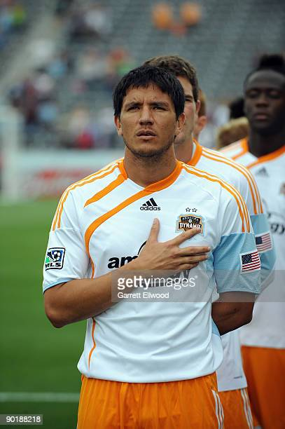 Brian Ching of the Houston Dynamo stands for the national anthem prior to the game against the Colorado Rapids on August 30 2009 at Dicks Sporting...