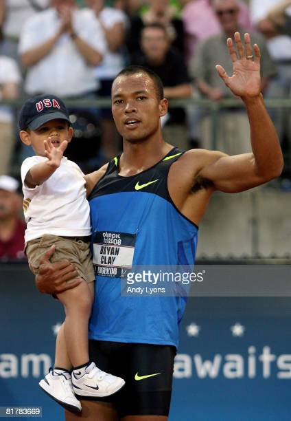 Brian Clay and his son pose after Clay won the gold medal in the Decathlon with a score of 8832 during day four of the US Track and Field Olympic...